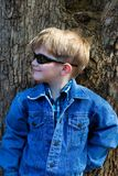 Child fashion. Children fashion, cute blonde boy dressed in jeans Stock Photos