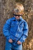 Child fashion. Children fashion, cute blonde boy dressed in jeans Stock Image