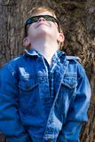 Child fashion. Children fashion, cute blonde boy dressed in jeans Royalty Free Stock Photos
