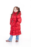 Child Fashion. Girl in fashionable winter down clothes royalty free stock photo
