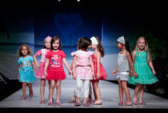 Child Fashion Show. VALENCIA, SPAIN - JULY 1: Unidentified child models walk the runway at the FIMI Children's Summer Fashion Show for designer Mim-Pi in the Royalty Free Stock Photos