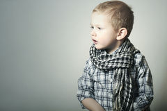 Child. Fashionable Funny little Boy in Scurf. Fashion Children Stock Image