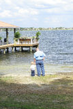 Child with father at the lake vertical Stock Photo