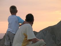 Child and father looking on sunset Stock Images