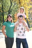 Child with father and mother stock photography