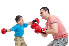 Child and father play with boxing gloves Stock Image