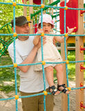 Child and father on  playground Stock Photos