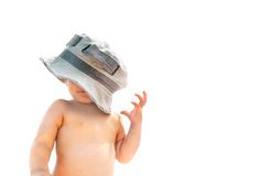 Child in father's hat Stock Photo