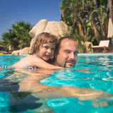 Child and father in swimming pool Stock Photos