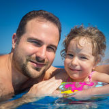 Child and father in swimming pool Royalty Free Stock Image