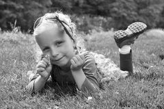 A child with a feather and a flower Royalty Free Stock Photos