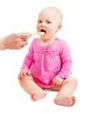 Child fed from the spoon Stock Photo