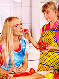 Child feed mother  at kitchen Royalty Free Stock Photos