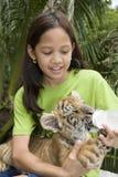 Child feeding baby tiger. In a Zoo in Bangkok stock photos