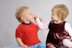 Child feeding boy Stock Photography