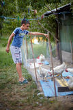 Child feeding chickens in the countryside Royalty Free Stock Images