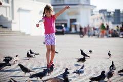 Child feeding doves Royalty Free Stock Image