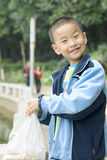 A child  at feeding fish Stock Photography