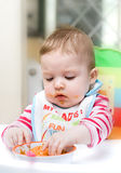 Child feeding herself. Royalty Free Stock Image