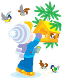 Child feeds birds Royalty Free Stock Images