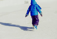 Child feet learning to skate on ice in winter Royalty Free Stock Photo