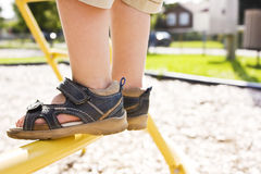 Child feet in a playground stock images
