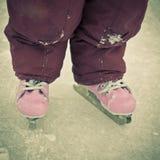 Child feet on skates Stock Photo