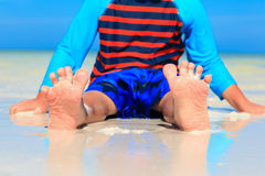 Child feet on summer sand beach Stock Photography