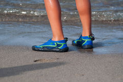 Child feet on water Stock Image