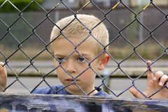 Child through fence Royalty Free Stock Image