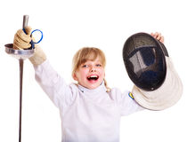 Child in fencing costume holding epee. Stock Photo
