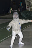 Child fencing with epee Stock Photography