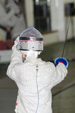Child fencing with epee Royalty Free Stock Photo