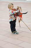 Child fiddling with shadow(21st UNIMA) Stock Photo