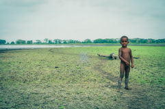 Child on field in Papua New Guinea Royalty Free Stock Images