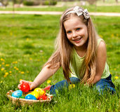 Child find easter egg outdoor. Stock Photo