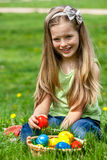 Child find easter egg outdoor. Stock Photos