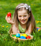 Child find easter egg outdoor. Royalty Free Stock Images