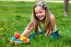 Child find easter egg outdoor. Royalty Free Stock Photos