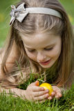 Child find easter egg outdoor Royalty Free Stock Images