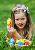 Child find easter egg outdoor Royalty Free Stock Photos