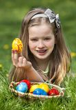 Child find easter egg outdoor Stock Photos