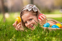 Child find easter egg outdoor Stock Images