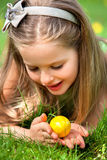 Child find easter egg outdoor. Stock Image