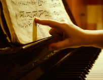 Child finger at music sheet. Child pointing finger at old Bach music sheet close-up Royalty Free Stock Photos
