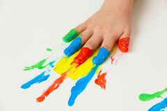 Child with finger paints colors. A child painting with finger paints. funny and creative Royalty Free Stock Image