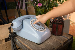 Child finger presses the button on the old phone Stock Images