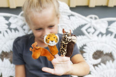 Child with finger puppets Stock Photos