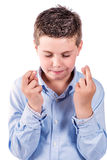 Child fingers crossed Stock Photos