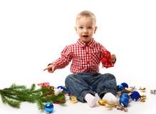 Child with fir branch Stock Image